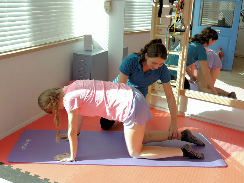 Osteopath showing exercises